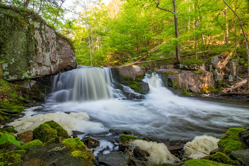 A long exposure photo of the Middle Falls on a May morning at John Burroughs Nature Sanctuary.