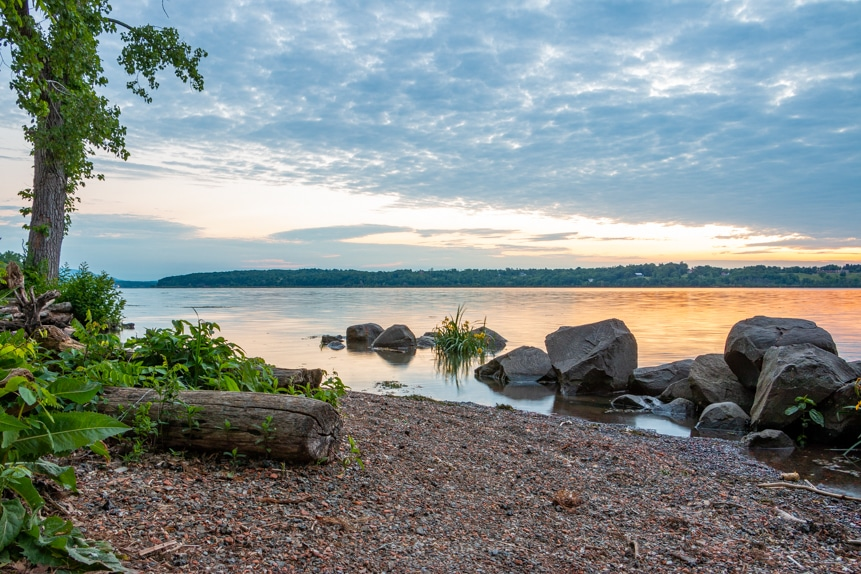 A photo of a sunrise along the shore of the Hudson River on a June morning at Lighthouse Park.