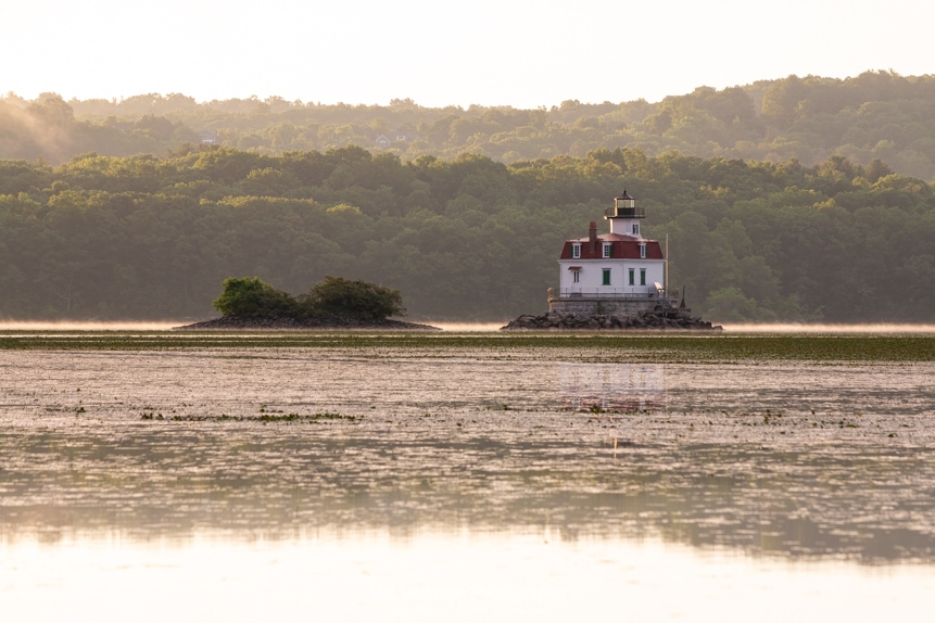 A photo of the Esopus Lighthouse on a lightly mist covered Hudson River during the golden hour of sunrise.