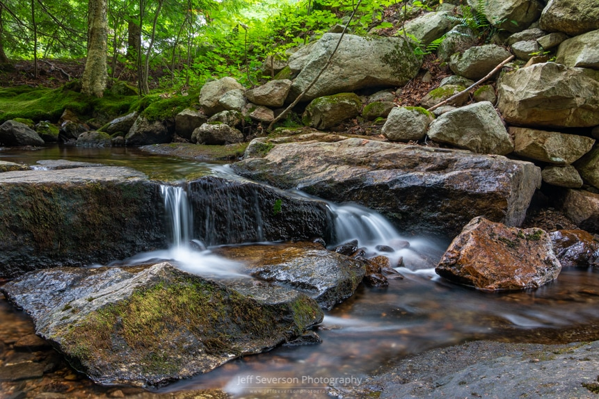 A long exposure photo of a mini waterfall on the Coxing Kill at Mohonk Preserve.