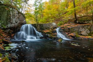 A long exposure photo of a waterfall along Black Creek in Esopus, NY on an October morning.