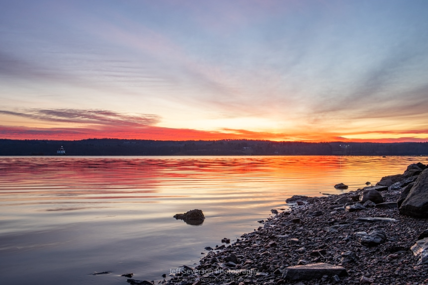 A photo of a sunrise over the Hudson River on a December morning.