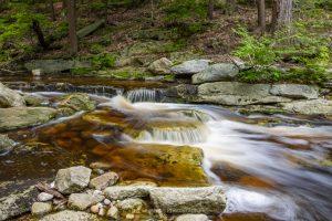 A long exposure photo of mini waterfalls on the Peterskill at Minnewaska State Park Preserve