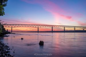 A photo of a June sunrise over over the Hudson River's Kingston-Rhinecliff Bridge.